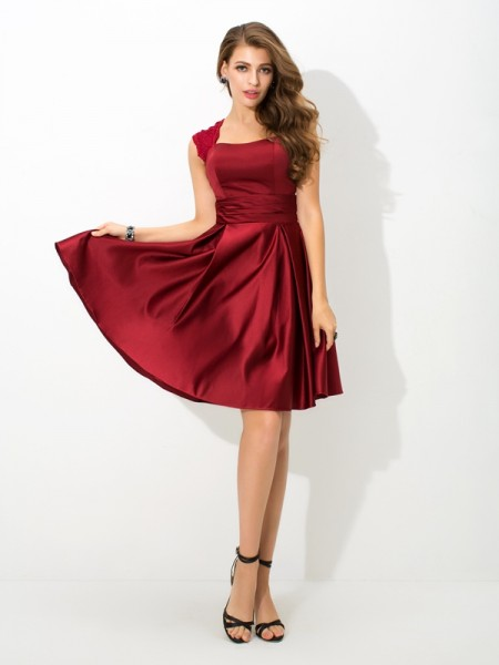 A-Line/Princess Straps Sleeveless Short/Mini Satin Bridesmaid Dress with Pleats